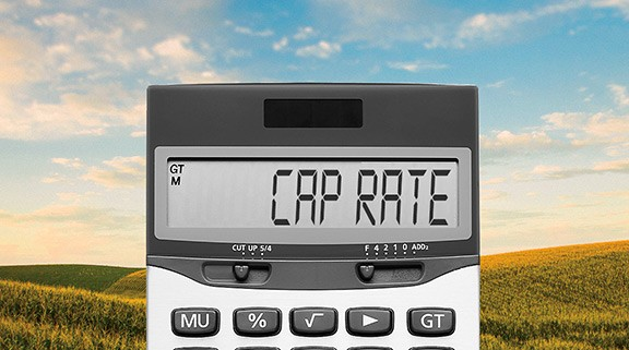 Calculator with cap rate in display